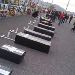 22 Black Coffins to Remember the 22 who lost their lives at the hands of a White Supremacist